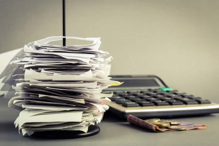 invoices and a calculator on a desk