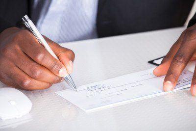 Human Hand Writing On business Check