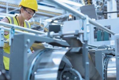 Manufacturing worker using machine