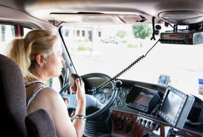 female truck driver behind the wheel